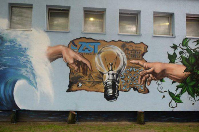 Mural inspirowany freskiem Michała Anioła-Stworzenie Adama Zespół Szkół Technicznych w Czestochowie